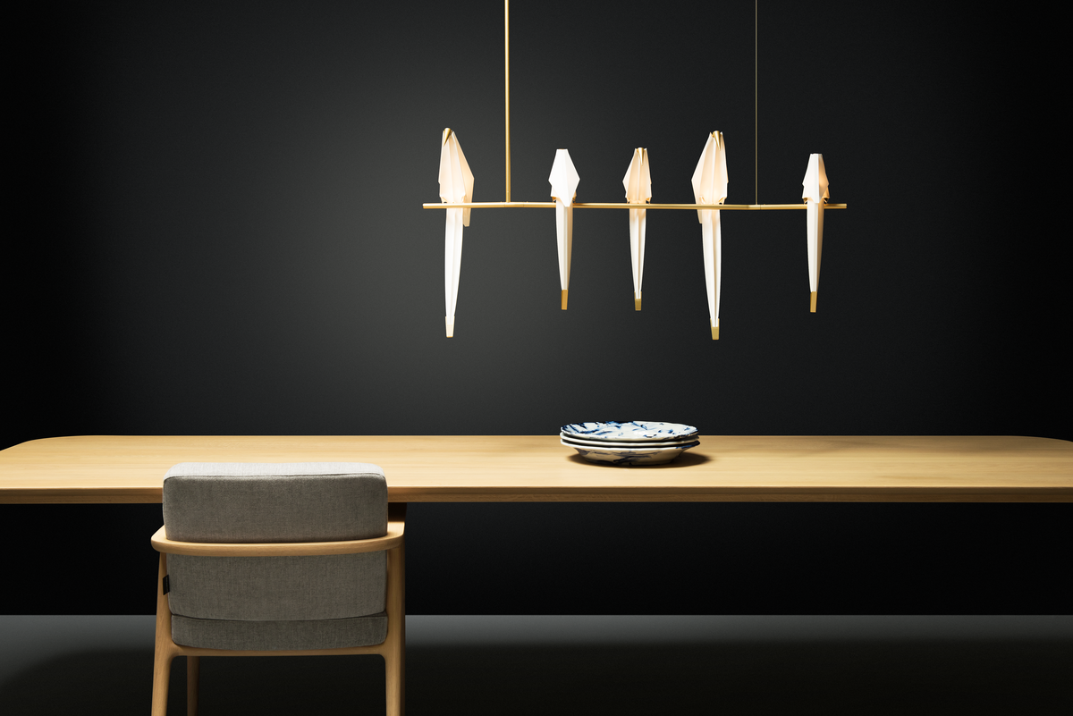 Perch Light Branch above dining table with black background