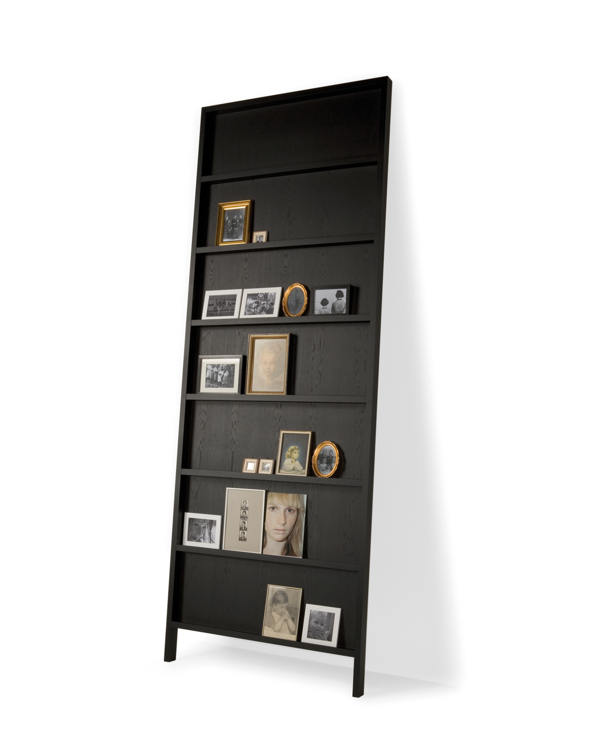 Oblique bookshelf big black stained wood front view with picture frames