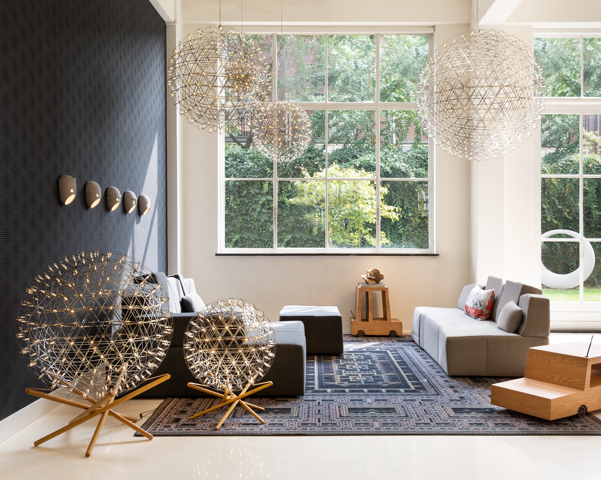 Interior of Amsterdam Showroom with Raimond Tensegrity floor lamp, Raimond suspension light and Something Like This Sofa