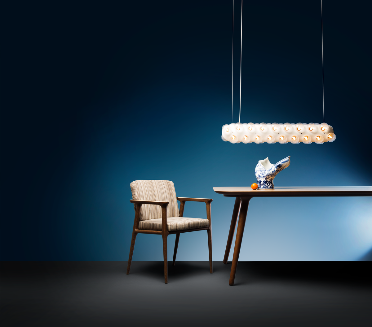 Poetic composition Zio Dining Chair, Zio Dining Table, Blow Away Vase and Prop Light suspension